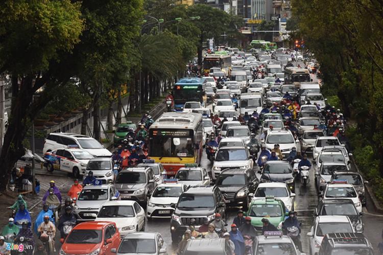 heavy rain serves to ease air pollution in hanoi hinh 5
