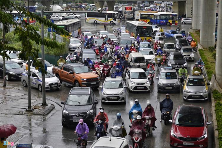 heavy rain serves to ease air pollution in hanoi hinh 8