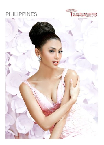 tuong san shines during glam shot segment at miss international pageant hinh 12