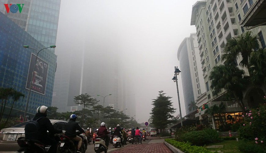dense fog descends on the streets of hanoi hinh 11