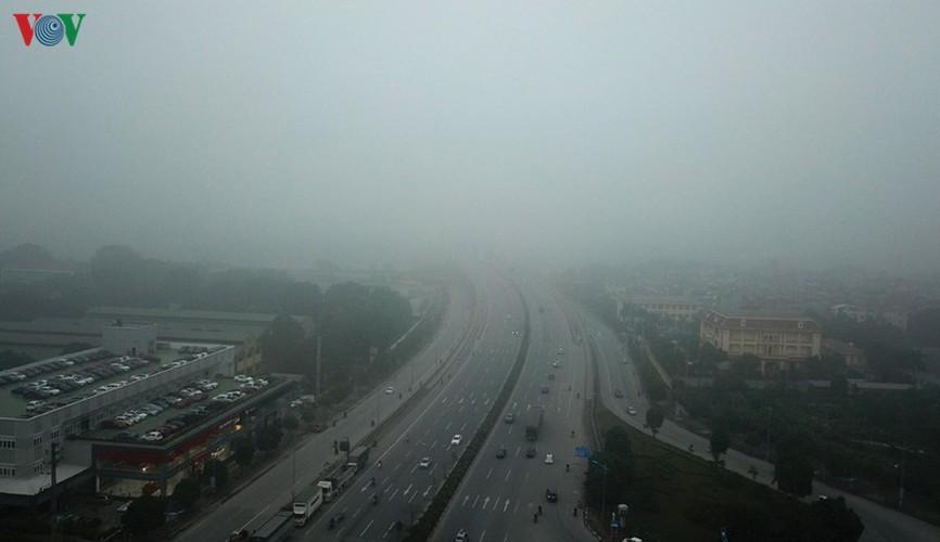dense fog descends on the streets of hanoi hinh 4