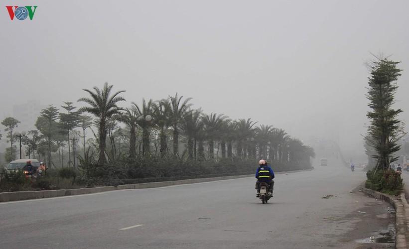 dense fog descends on the streets of hanoi hinh 5