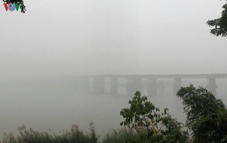 dense fog descends on the streets of hanoi hinh 7