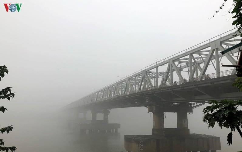 dense fog descends on the streets of hanoi hinh 8