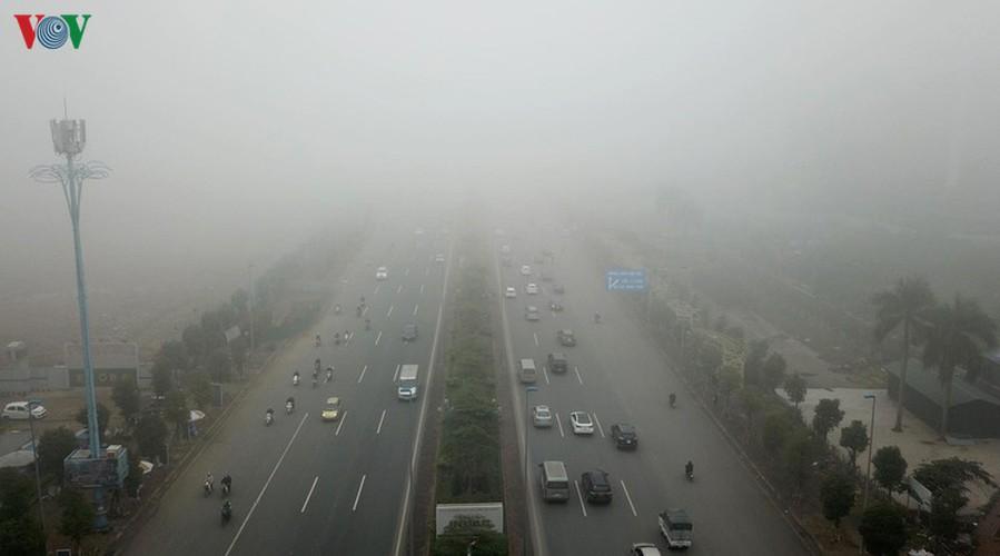 dense fog descends on the streets of hanoi hinh 9