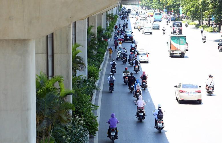 hanoi endures second heat wave, temperatures drop in hcm city hinh 10