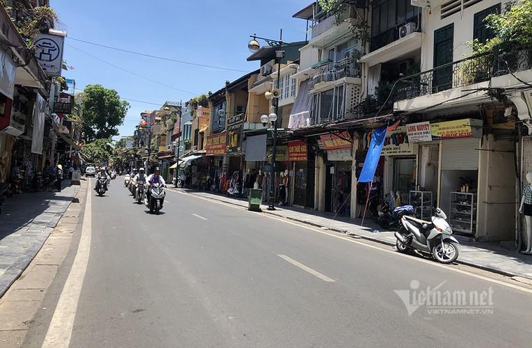 hanoi endures second heat wave, temperatures drop in hcm city hinh 4
