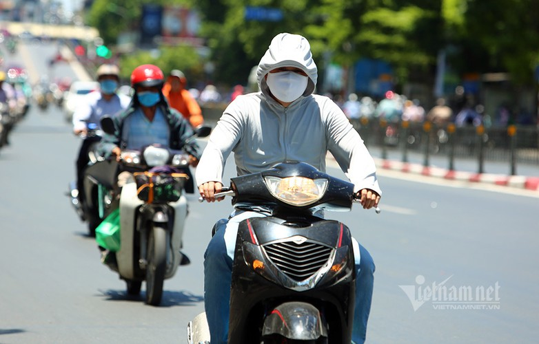 hanoi endures second heat wave, temperatures drop in hcm city hinh 6