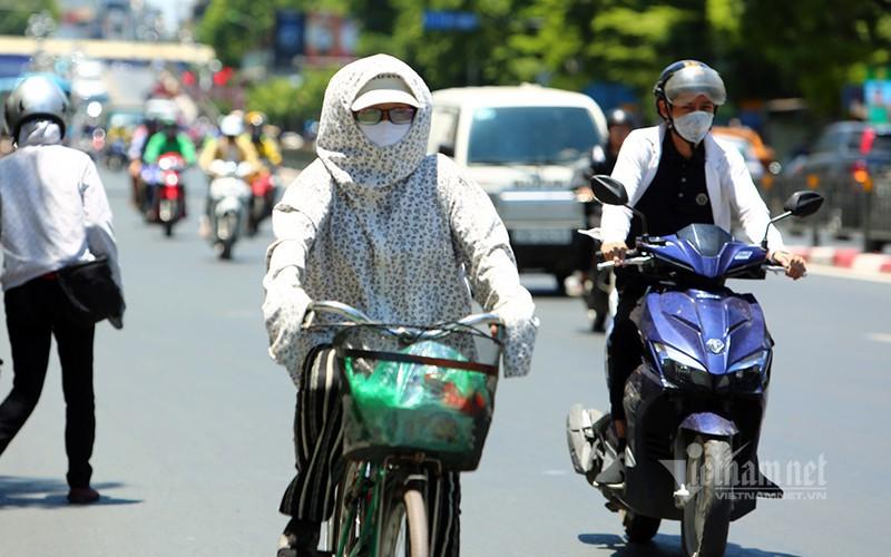 hanoi endures second heat wave, temperatures drop in hcm city hinh 7