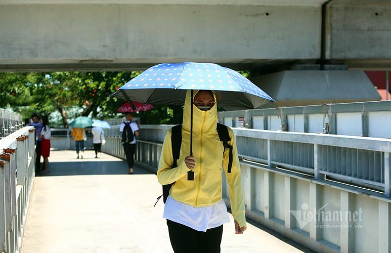 hanoi endures second heat wave, temperatures drop in hcm city hinh 9