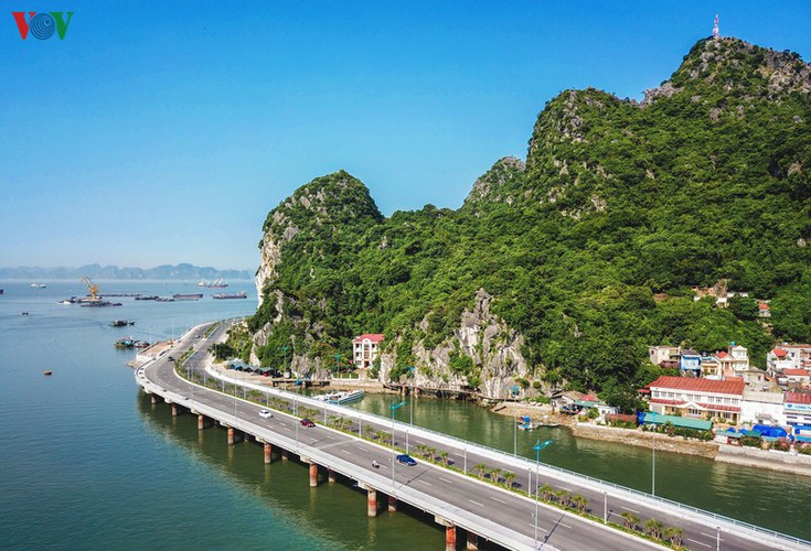 discovering scenic coastal road in ha long hinh 2