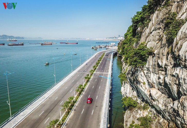 discovering scenic coastal road in ha long hinh 4