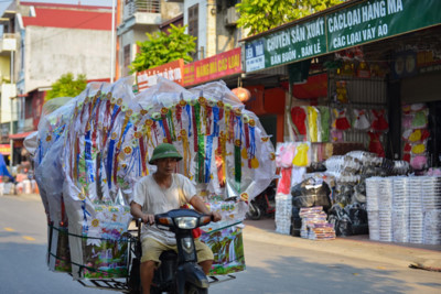 Song Ho commune make paper offerings ahead of Ghost Month