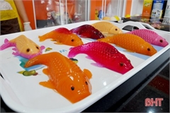 Carp-shaped food items popular snacks on Kitchen Gods Day