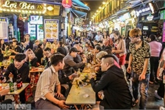 Return of foreign tourists breathes energy back into Ta Hien street