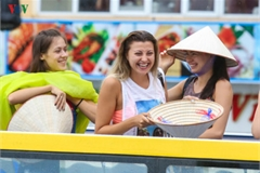 Foreigners enjoy scenic views onboard double decker buses in Ha Long