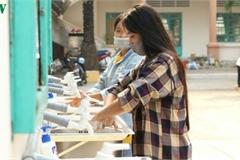 Vietnamese students return to school after coronavirus epidemic under control