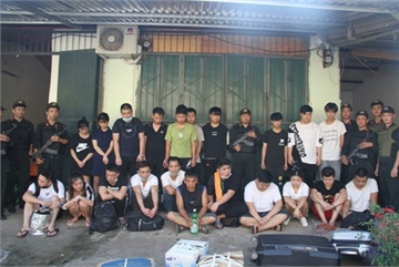 Vietnam detains 21 Chinese fugitives in disguised farm