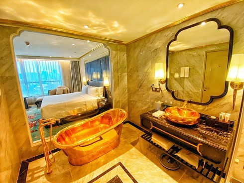 what makes hanoi's first gold-plated hotel special? hinh 10