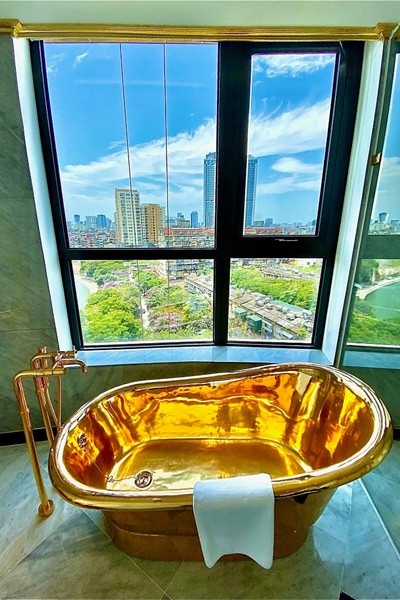 what makes hanoi's first gold-plated hotel special? hinh 11
