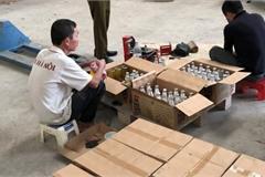 Phát hiện gần 70.000 chai nước ngọt hết hạn bị tẩy xóa