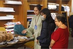 People eager to exchange plastic bottles for socks in HCM City