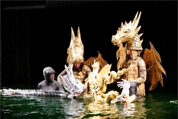 Water puppeteers find dry land on stage