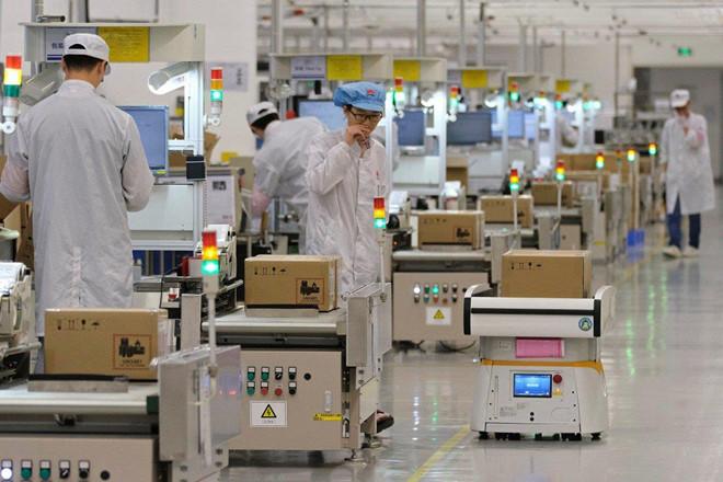 Huawei: 'Chung toi khong cat giam san xuat smartphone' hinh anh 1