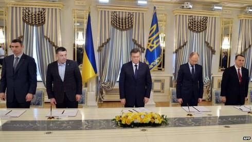 Ukraine: Chính phủ và phe đối lập đã thỏa hiệp - ảnh 1