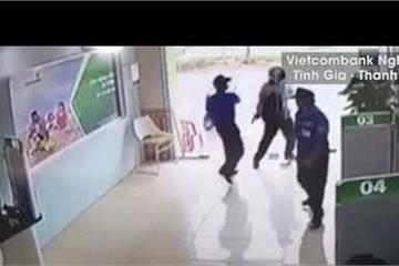 Thượng úy Công an xông vào ngân hàng nổ súng: Tội danh gây rối trật tự có thỏa đáng?