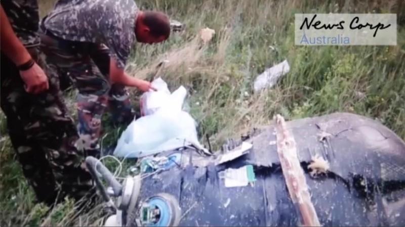 Những gì còn sót lại của chuyến bay định mệnh MH17 - ảnh 7