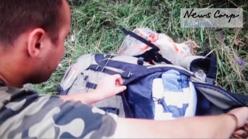 Những gì còn sót lại của chuyến bay định mệnh MH17 - ảnh 8