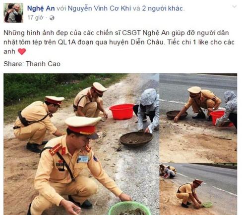 Nghệ An: CSGT giúp dân thu gom tôm, cua đổ giữa đường - ảnh 1