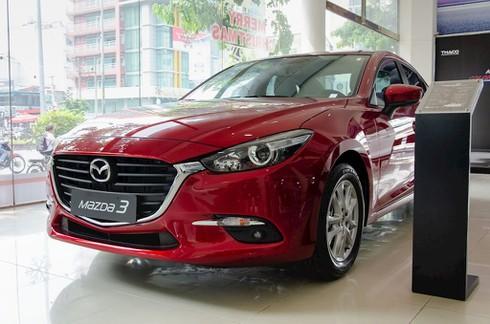 Mazda3 giảm giá cả trăm triệu - ảnh 1