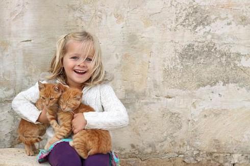 Nuôi thú cưng giúp trẻ học kỹ năng sống - ảnh 1