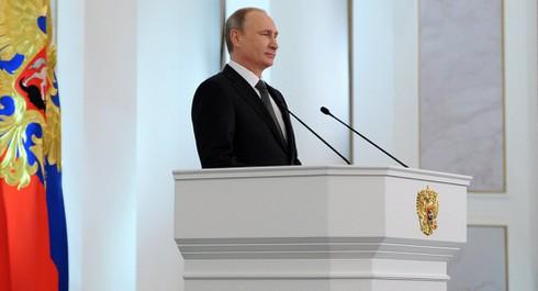 """Tin thế giới 18h30: Putin đọc Thông điệp Liên bang, Anh """"xả bom"""" xuống Syria - ảnh 1"""