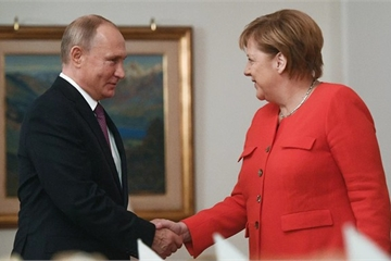 Người dân Đức chọn ông Putin, bà Merkel là chính trị gia của năm 2020