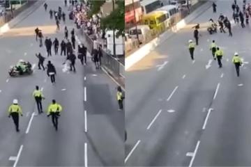 Clip Cảnh sát HongKong lao xe vào đám đông, lượn vòng vèo như rắn