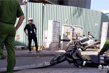 TP.HCM: Ván gỗ từ công trình cao ốc Etown 5 rơi trúng đầu người đi đường