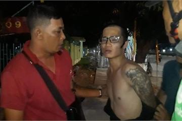 """Bình Dương: Gã đàn ông xăm kín tay tống tiền người tình bằng clip """"nóng"""""""