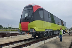 Close-up of first train of Hanoi's second metro line put on rails