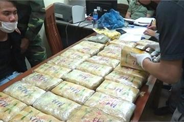 'Khui' bao tải chứa 180.000 viên hồng phiến, 2 bánh heroin và 1kg ma túy đá