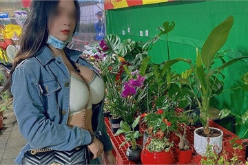 Đi chợ hoa Tết, cô gái bị chỉ trích vì mặc bộ đồ khoe vòng 1 phản cảm