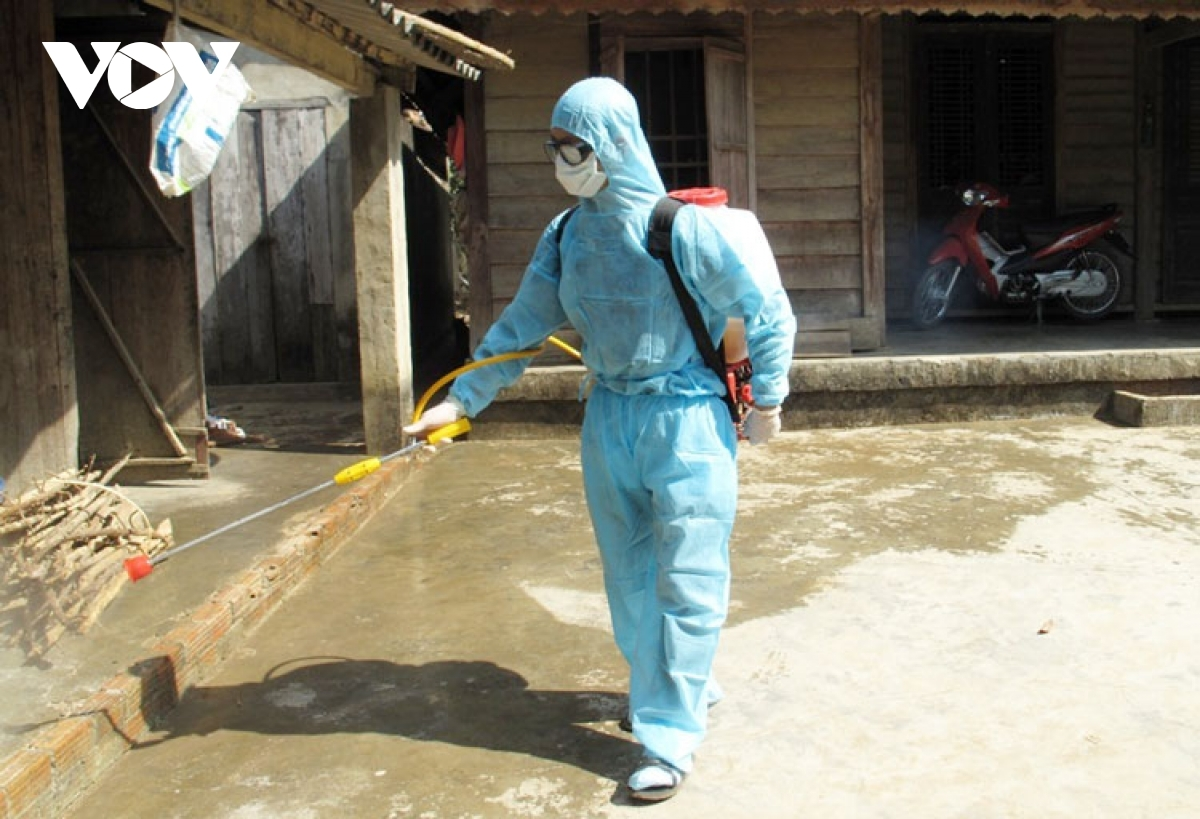 Health worker sprays chemical to kill mosquitoes