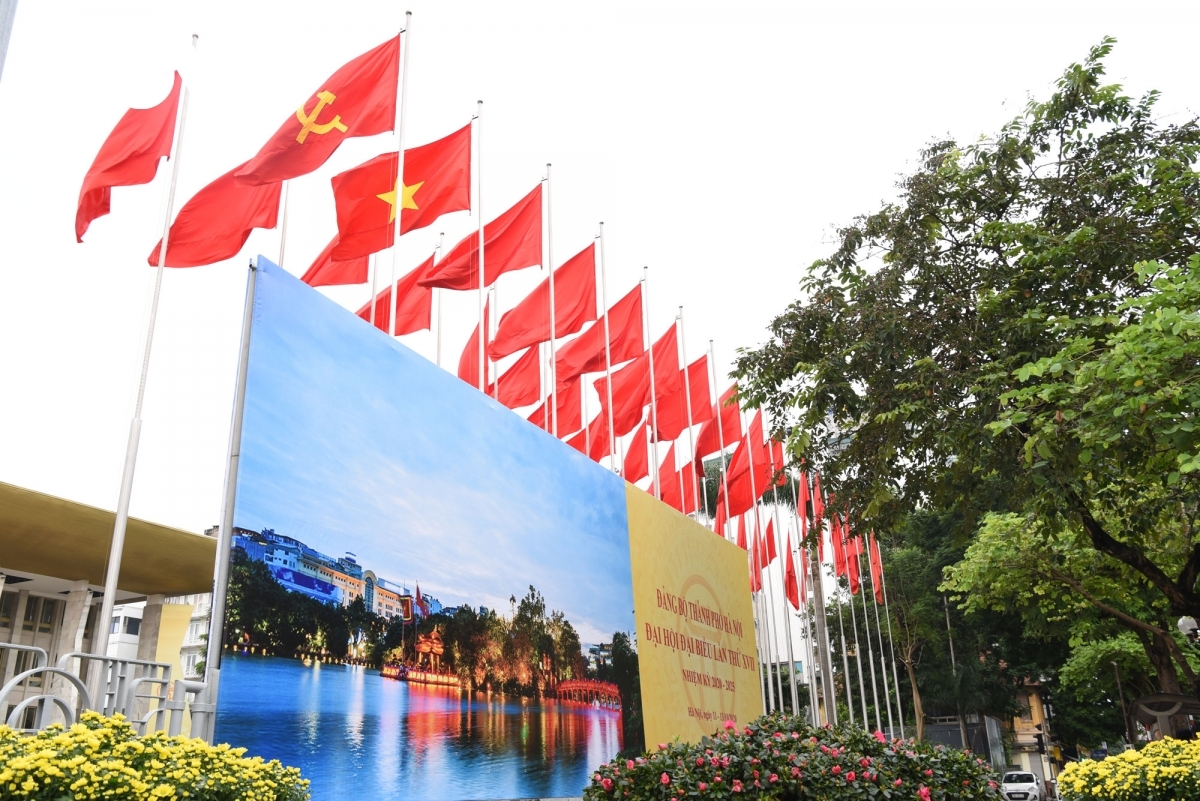 National flags can be seen fluttering under the peaceful sky.