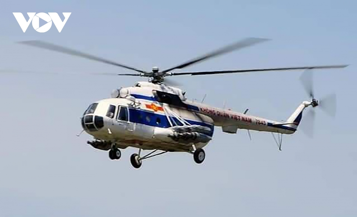 The Mi-171Ehelicopter by the Vietnamese Air Force takes off from Phu Bai airport to join in ongoing rescue efforts