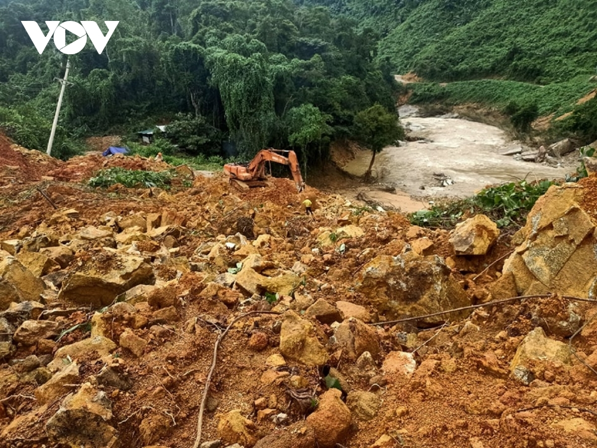 Excavators are utilised to remove soil as the search for missing victims at Rao Trang 3 Hydropower Plant gets underway