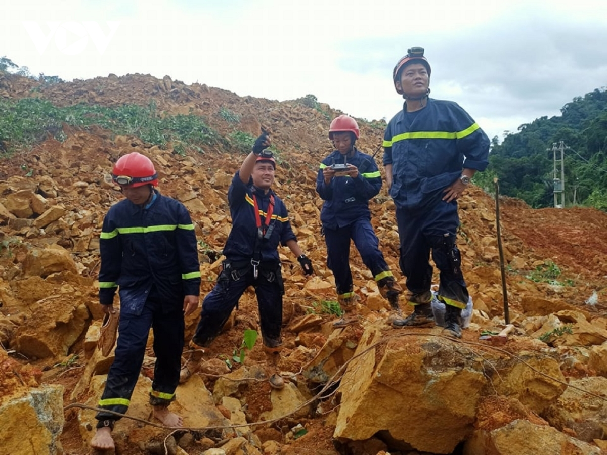 Rescue workers use all equipment available to survey the landslide area where 17 workers have been buried