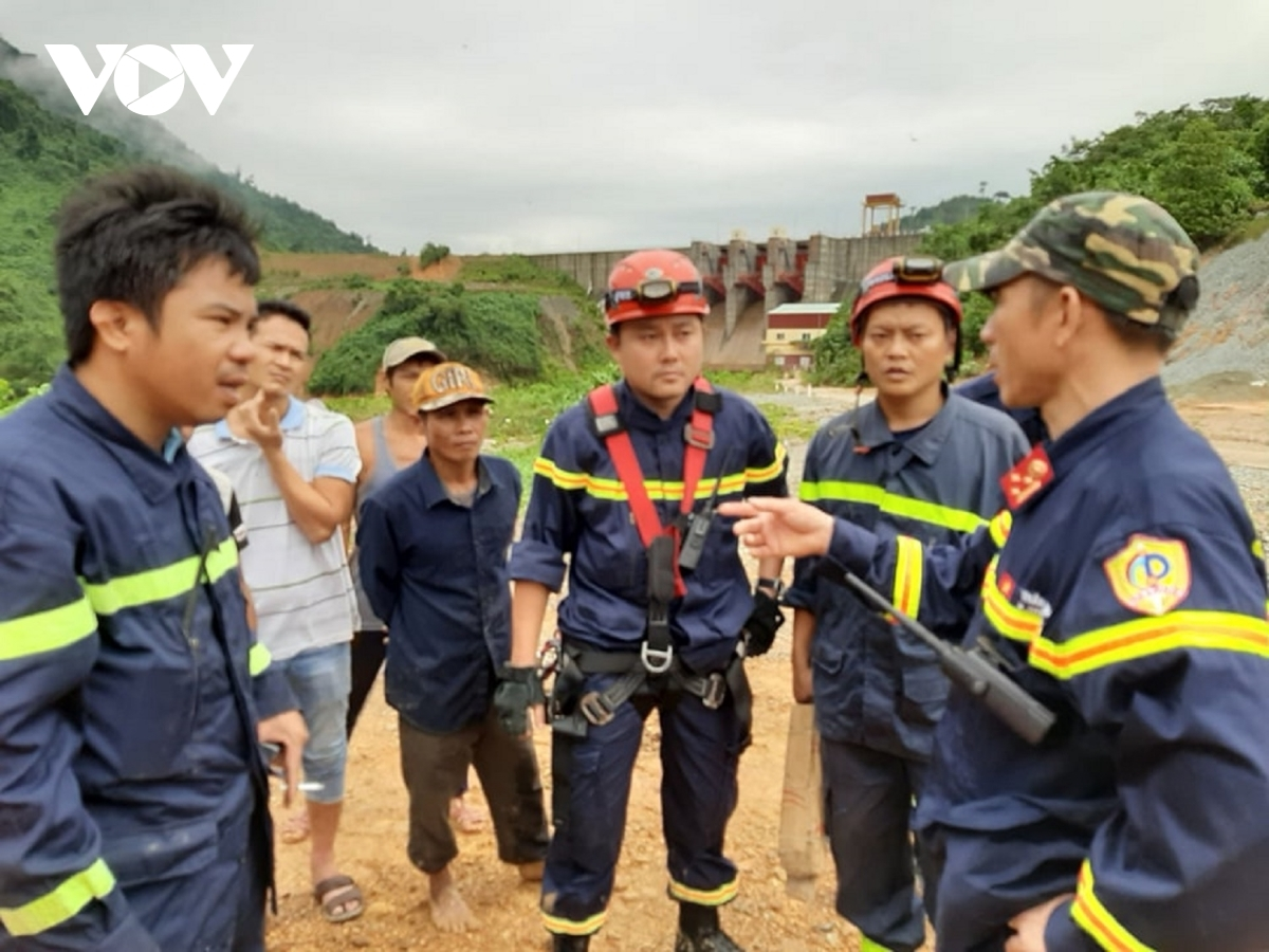 Rescue teams discuss their plans to search for the missing