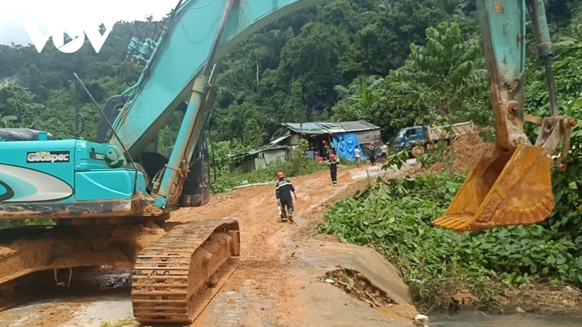 An excavator is used to clear mud that has hit the route leading towards the site